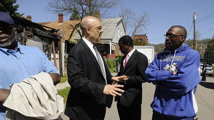 Ricky Burgess City Councilman Rev. Ricky Burgess, left, talks to Homewood resident Brandon Murray on Wednesday at the intersection of Collier Street and Formosa Way.