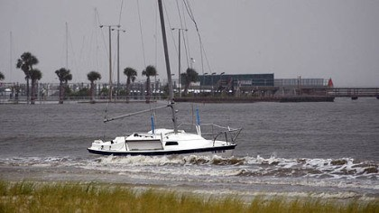 Rising water A sailboat is grounded Tuesday morning on the beach in Pass Christian, Miss., as Hurricane Isaac approaches.