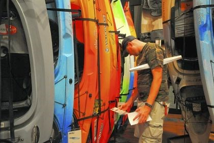 Rob Hasenflu Rob Hasenflu of Rochester checks kayak prices at Field & Stream in Cranberry.