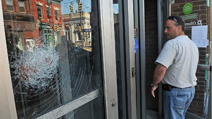Robbery attempt A Pittsburgh police officer looks at the shattered door of the Citizens Bank on Butler Street in Lawrenceville after a Thursday morning robbery attempt.