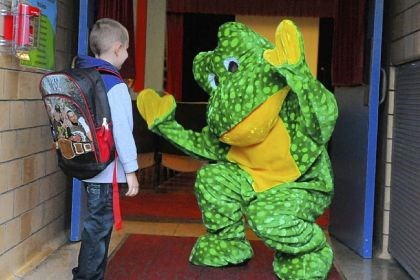 Robert Schmuck meets Ready Freddy Robert Schmuck, 5, of Spring Hill meets Ready Freddy, a frog mascot, before the first day of kindergarten Thursday at Pittsburgh Spring Hill K-5.