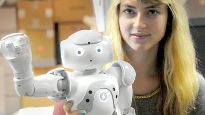 Robot Little Toby CMU doctoral student Heather Knight with her robot Little Toby.