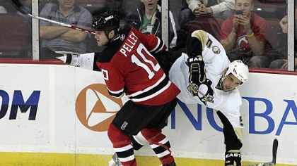Rod Pelley and Deryk Engelland Devils forward Rod Pelley flips Penguins defenseman Deryk Engelland during the third period.