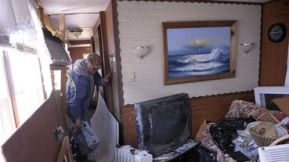 Roger Hacker, of Doylestown, Pa. Roger Hacker, of Doylestown, Pa., on Friday finds the lunch cooler his wife liked among the debris in his mobile home in Holgate, Long Beach Island, N.J., where they had vacationed for many years.