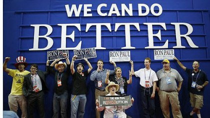 Ron Paul Ron Paul supporters pose for a picture after an abbreviated session of the Republican National Convention.