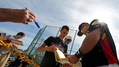 Ronny Paulino Pirates catcher Ronny Paulino signs autographs for fans during the first day of workouts for pitcher and catchers yesterday at Pirate City in Bradenton, Fla.