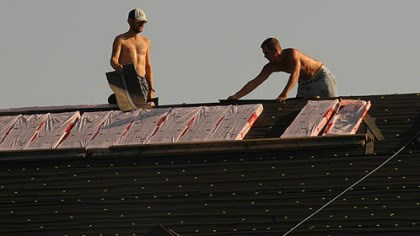 roofing in hot weather Keith Sines and Fred Interthal work with shingles at a shopping center along Route 8 in Richland Township., Because of the severe heat wave the crew starts at 5 a.m. and work till noon. In the extreme heat, the shingles get too soft.