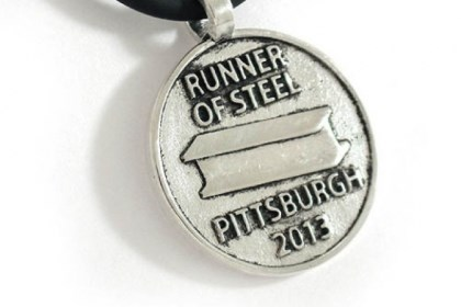 "'Runner of Steel' pendant ""Runner of Steel"" pendant on a rubber sports chain with sterling silver clasp, $68 by Caesar's Designs."