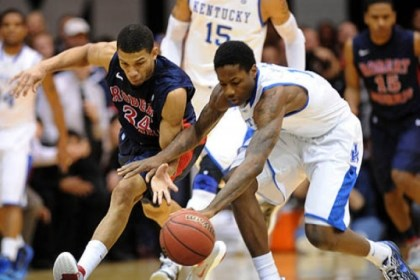 Russel Johnson Robert Morris University's Russel Johnson and Kentucky's Archie Goodwon scramble for a loose ball during the first round of the NIT.