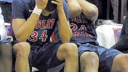 Russell Johnson and Lawrence Bridges A dream denied, Robert Morris' Russell Johnson and Lawrence Bridges wait out the final seconds in Brooklyn.