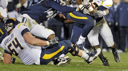 Ryan Clarke Ryan Clarke's fumble in overtime set up Connecticut's winning field goal Oct. 29 in East Hartford, Conn.