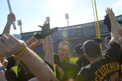 Ryan Lightcap cheers Ryan Lightcap, 21, center, cheers Sunday with his friends from Indiana, Pa., after the Pirates scored two runs in the bottom of the first inning of Game 3 of the National League Division Series at PNC Park.