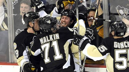 Ryan Malone The Penguins' Ryan Malone is smothered by teammates after scoring the winning goal against Ottawa in the third period of Game Two last night at Mellon Arena.