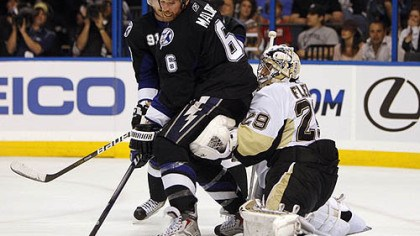 Ryan Malone and Marc-Andre Fleury Penguins goaltender Marc-Andre Fleury defends the net against Lightning forward Ryan Malone during Wednesday's Game 4 at the St. Pete Times Forum in Tampa, Fla.