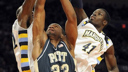Sam Young, Lawrence Blackledge and Ousmane Barro Pitt's Sam Young drives to the net against Marquette's Lawrence Blackledge and Ousmane Barro in the first half of of their semifinal game in the Big East Tournament last night.