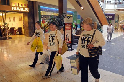 "Sam Zeigler, Lois Bellflower and Lisa Fetty From left, Sam Zeigler, Lois Bellflower, both of Hahira, Ga., and Lisa Fetty of Toronto, Ohio, wear their custom ""Black Friday BFF"" shirts while shopping Nov. 23 at the Mall at Robinson."