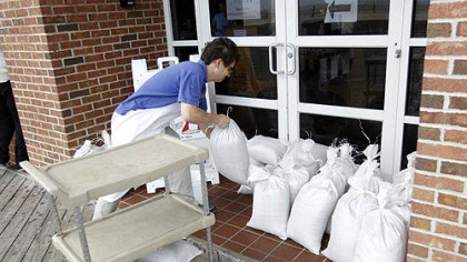 Sand bag preparations for Sandy A restaurant worker piles sand bags at the entrance of the business in Ocean City, Md., as Hurricane Sandy approaches the Atlantic Coast on Saturday.