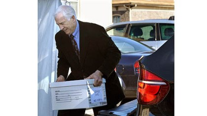 sandusky day 3 Jerry Sandusky helps unload case files from his attorney's car as he arrives at the Centre County Courthouse for the third day of his trial.