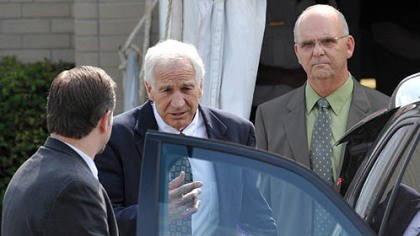 sandusky pm Jerry Sandusky leaves the Centre County Courthouse after the second day of testimony in his trial. At left is his attorney Karl Rominger; Centre County Sheriff, at right is Centre County Sheriff Denny Nau.