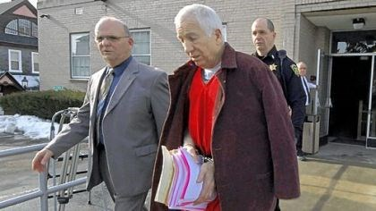 sandy and nau Former Penn State University assistant football coach Jerry Sandusky, center, leaves the Centre County Courthouse on Thursday, escorted by Centre County Sheriff Denny Nau, left, after attending a post-sentence motion hearing in Bellefonte.