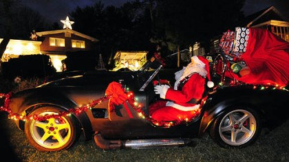 Santa in a Shelby Santa rides in in a 1965 Shelby Cobra kit car made by Carol Vincini's son, Mike Palmer, an artist and mechanical engineer.
