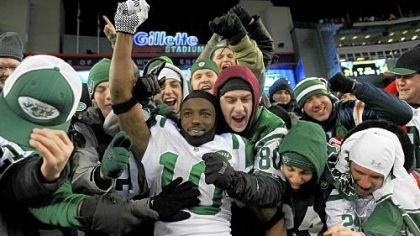 Santonio Holmes Santonio Holmes of the New York Jets celebrates with fans after the Jets defeated the Patriots 28-21 in their AFC divisional playoff game at Gillette Stadium Sunday.