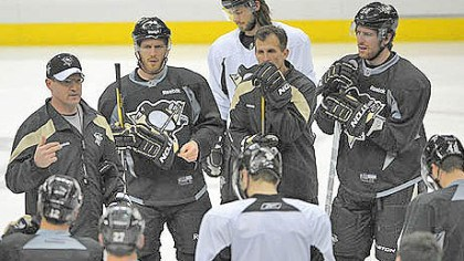 Saturday practice The Penguins gathered around head coach Dan Bylsma, left, as they practiced at the Consol Energy Center today before heading to Philadelphia for tomorrow's Game 6.