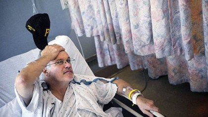 Saved at ballpark Charles Trimble of Corry, Erie County, talks from his bed at Allegheny General Hospital yesterday.