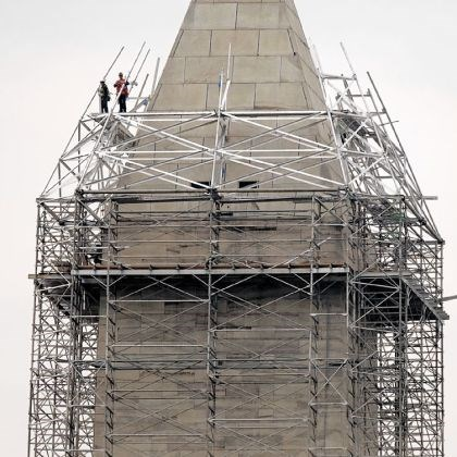 Scaffolding rises Scaffolding rises to the top of the Washington Monument so craftsmen can make repairs to the 555-foot marble obelisk that was damaged in the August 2011 earthquake.