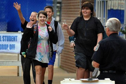 School days Students wave to each other as they enter Shaler Area Middle School this morning.