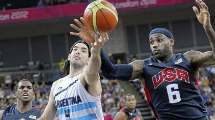scola Argentina's Luis Scola and the United States' LeBron James reach for a loose ball during the men's semifinal Friday in London.