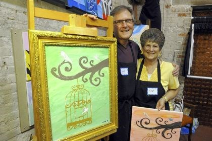 "Scott Frazier and Tish Smith After a session at Paint Monkey in the Ice House Studio, Scott Frazier of McCandless shows off his finished ""Victorian Birdcage"" painting with his cousin Tish Smith of Centre Hill, Centre County."