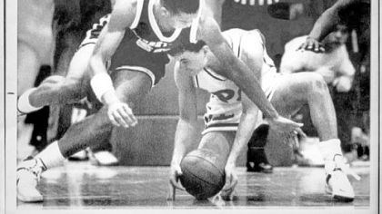 SeanMiller.jpg Pitt guard Sean Miller, right, grabs a loose ball from Georgetown's Sam Jefferson in a game Feb. 20, 1988 in Pittsburgh. Pitt defeated Georgetown, 70-65, in a game that was called off with 4 seconds on the clock because officials could not control the game.