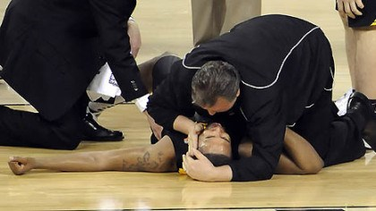 Second half injury West Virginia coach Bob Huggins comforts Da'Sean Butler after Butler injured his leg against Duke in the second half of the semifinal game in the NCAA tournament in Indianapolis last night.
