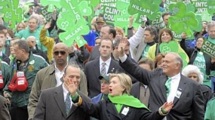 Sen. Clinton marches Democratic presidential candidate, Sen. Hillary Rodham Clinton, appeared in the St. Patrick's Day parade Downtown yesterday. She was accompanied by Allegheny County Chief Executive Dan Onorato on her right and Gov. Ed Rendell on her left.