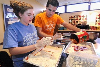 serve1 Jason Beiriger, left, and Emily Roman prepare lasagna Sunday as teens participating in the seventh annual J-Serve day of service for Jewish youth prepare a meal at the Ronald McDonald House at Children's Hospital of Pittsburgh of UPMC.