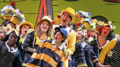 Seussical-2 The Mayor at right, played by Michael Bodomov, his wife, played by Sarah Hill, and their child JoJo, played by Laura Gitelman, with some of the Blue Cast ensemble.