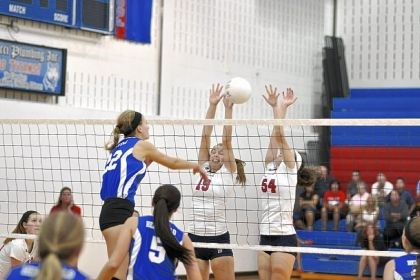 Shaler volleyball Shaler Area's Liz Rhodes (19) and Liz Kline (54) go up for a block against Hempfield Area in a match Sept. 7.