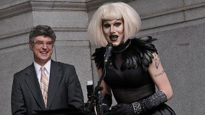 sharon needles 2 After having a proclamation read in City Council proclaiming June 12, 2012 as Sharon Needles Day in Pittsburgh, Needles speaks on the portico of the City-County Building before performing for her fans,. At left is Councilman Patrick Dowd, who sponsored the proclamation.