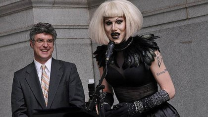 Sharon Needles speaks After having a proclamation read in city council proclaiming June 12, 2012, as Sharon Needles Day in Pittsburgh, Ms. Needles speaks on the portico of the City-County Building before performing for her fans. At left is Councilman Patrick Dowd, who sponsored the proclamation.