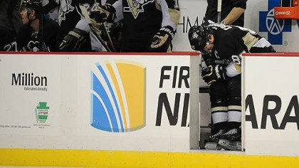 Sidney Crosby Sidney Crosby bends over in pain on the bench in the third period Monday after colliding with teammate Chris Kunitz. Crosby returned to the game against the Bruins, but was given a maintenance day at practice Tuesday. He is expected to practice today.