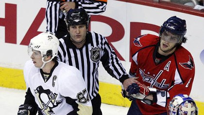 Sidney Crosby and Alex Ovechkin An official separates Sidney Crosby and Alex Ovechkin yesterday.