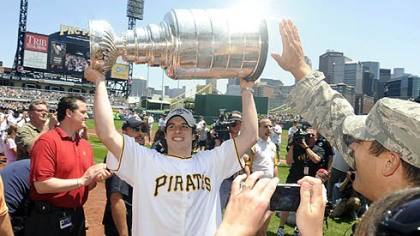 Sidney Crosby hoists the Stanley Cup Sidney Crosby hoists the Stanley Cup at PNC Park yesterday.