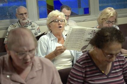 Sing a song Patti Ferari, center, the group's business manager, rehearses with the Monroeville Community Chorus Monday at the Good Shepherd Lutheran Church in Monroeville.