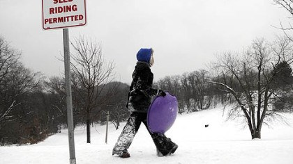 Sledder A sledder scouts for a spot to sled down the hill yesterday at Frick Park in Squirrel Hill.