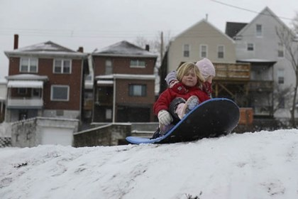 sledding greenfield Sisters Ana Jean, 5, (right) and Magdalen McDermott, 4, prepare for a sledding run in their yard in Greenfield on Sunday.
