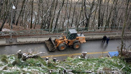 Slide A Pittsburgh Public Works Department crew cleans debris on McArdle Roadway today after a minor landslide.