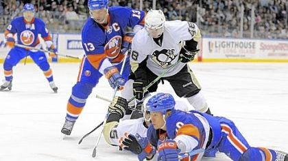 Slip and slide Mike Zigomanis, rear on ice, battles for the puck with the Islanders' Richard Park in their game last night in Uniondale, N.Y.