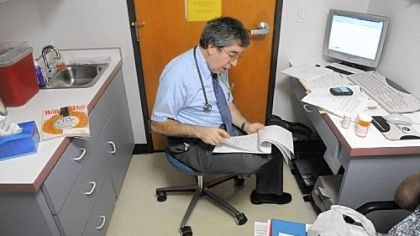 smaller practice Matthew Levin sees a patient at his family practice office in Greensburg.