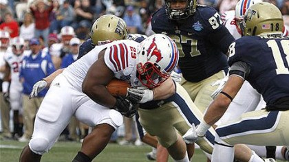 SMU TD SMU running back Rishaad Wimbley runs in a touchdown over Pitt offensive linesman Arthur Doakes in the first half of today's BBVA Compass Bowl game in Birmingham, Ala.